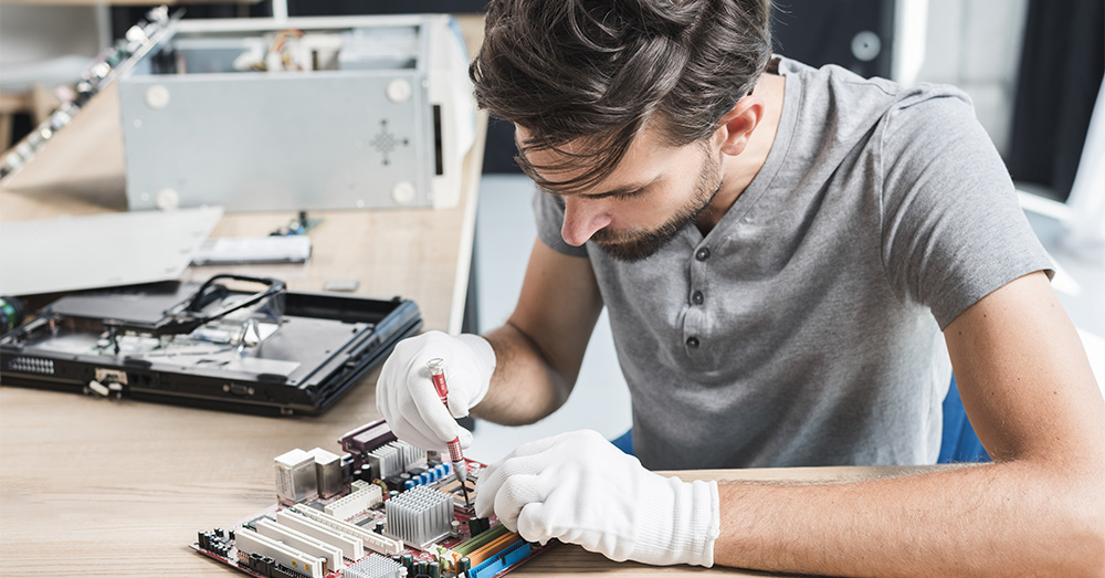 computer business by a male computer repairer