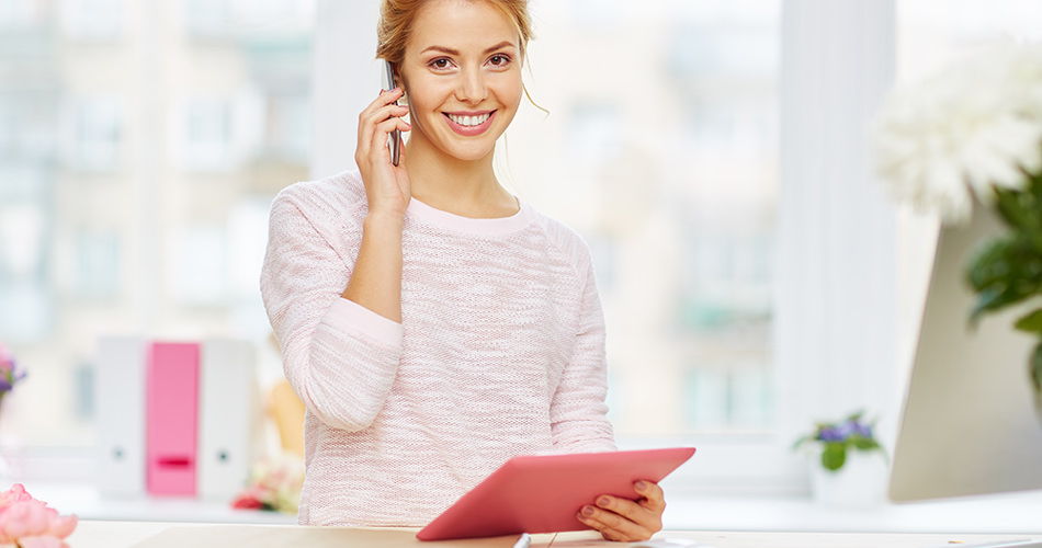 Business woman using mobile phone and tablet