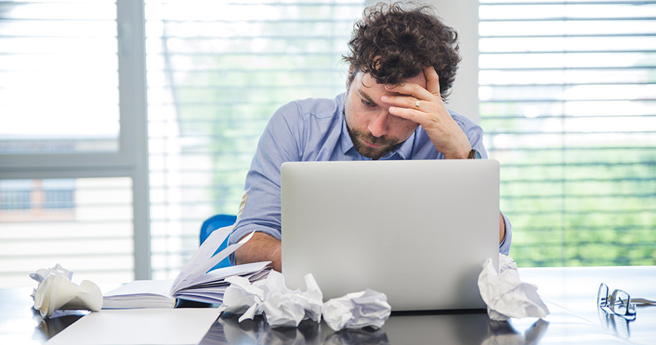 Overwhelmed man at office