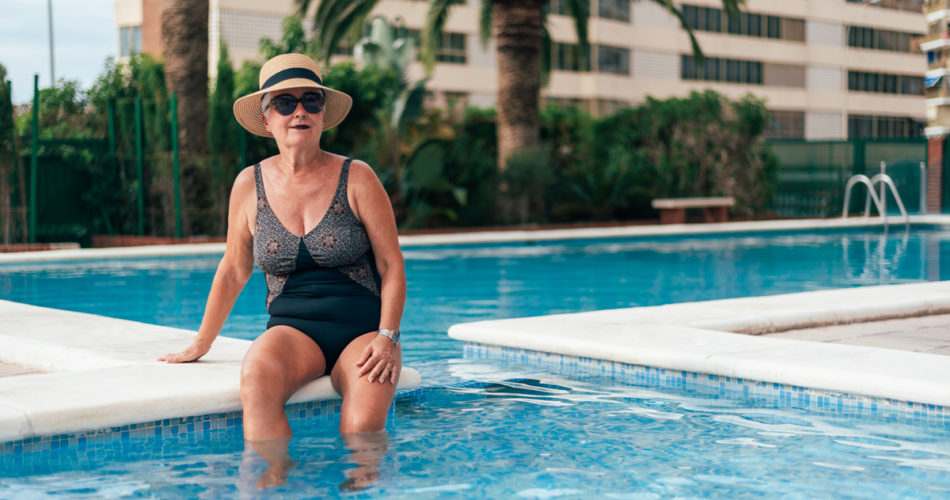 Old woman at a pool wearing a swimsuit